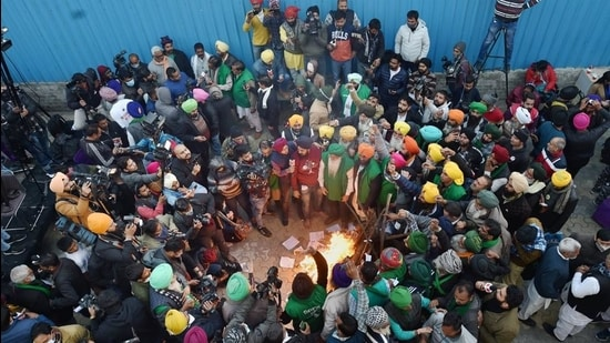 Farmers celebrate Lohri during their ongoing protest, at Singhu border in New Delhi on January 13. (File photo)