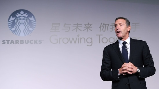 (FILES) This file photo taken on April 18, 2012 shows Howard Schultz, president and chief executive officer of Starbucks, delivering his speech at the Starbucks Partner Family Forum in Beijing. - China's President Xi Jinping asked former Starbucks chairman Howard Schultz to help promote relations between Washington and Beijing, state media reported on January 14, 2021, in a rare missive to a foreign business figure. (Photo by LIU JIN / AFP)(AFP)