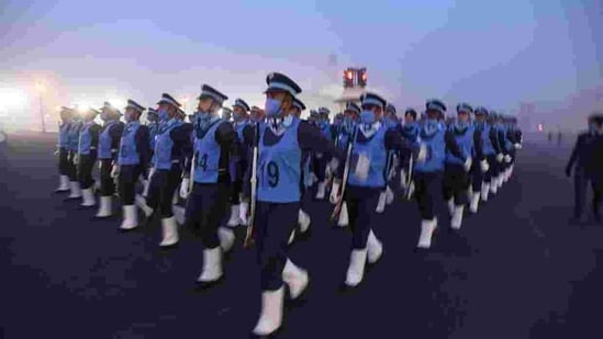 A cold wave gripped the national capital too. Here, Indian Air Force personnel can be seen rehearsing for the Republic Day parade at Vijay Chowk. (Raj K Raj/Hindustan Times)