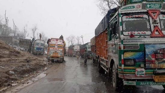 Trucks stranded on the highway Jammu-Srinagar highway after a retaining wall of bridge at Kela Morh in Ramban collapsed on January 10.(HT PHOTO)