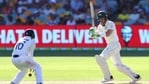 Australia's Tim Paine, right, hits the ball at India's Mayank Agarwal during play on the first day of the fourth cricket test between India and Australia at the Gabba.(AP)
