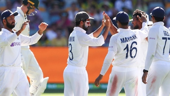 India's Thangarasu Natarajan, second right, is congratulated by teammates after dismissing of Australia's Marnus Labuschagne during play on the first day of the fourth cricket test between India and Australia at the Gabba, Brisbane, Australia, Friday, Jan. 15, 2021. (AP Photo/Tertius Pickard)(AP)