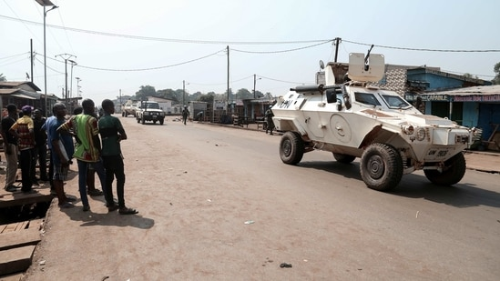 Residents watch as United Nations Multidimensional Integrated Stabilization Mission in the Central African Republic (MINUSCA) armoured personnel carrier (APC) keeps guard while patroling a few hours after the attacks in Begoua.(REUTERS)