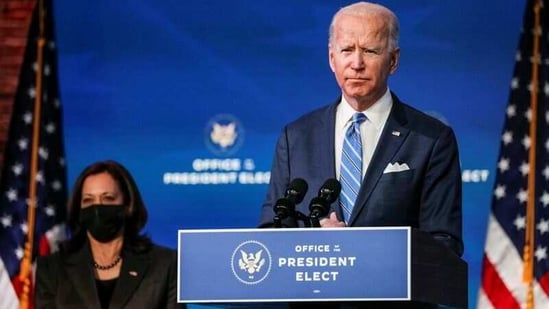 FILE PHOTO: U.S. President-elect Joe Biden delivers remarks as Vice President-elect Kamala Harris looks on during a televised speech on the current economic and health crises at The Queen Theatre in Wilmington, Delaware, U.S., January 14, 2021. REUTERS/Tom Brenner/File photo(REUTERS)