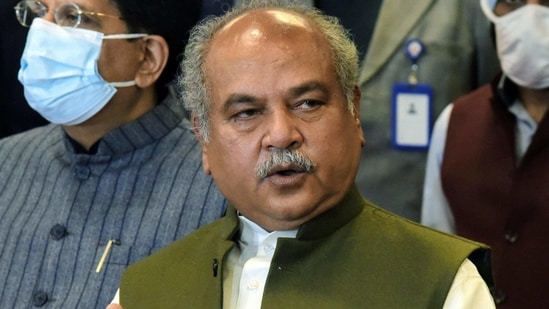 Union Agriculture Minister Narendra Singh Tomar addresses a press conference after meeting with Farmers Union leaders on farm laws, at Vigyan Bhawan in New Delhi on Friday. Union Ministers Piyush Goyal and Som Prakash also seen along with him. ((ANI Photo))