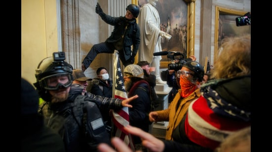 Pro-Trump protesters storm the Capitol Building, January 6. (REUTERS)