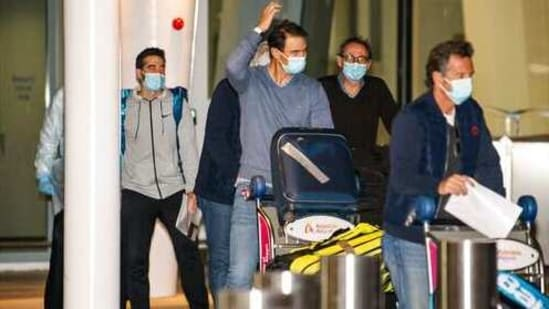 Spain's Rafael Nadal, center, arrives at Adelaide Airport ahead of the Australian Open tennis championship, Adelaide, Australia, Thursday, Jan. 14, 2021. Arriving players will serve a 14-day quarantine period ahead of the first Grand slam tennis tournament that is set to get underway on February 8 in Melbourne. (Morgan Sette/AAP Image via AP)(AP)