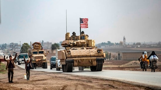 At Trump's order, commanders also cut US troop levels in Iraq to 2,500 from about 3,000 in the same period.(AFP)