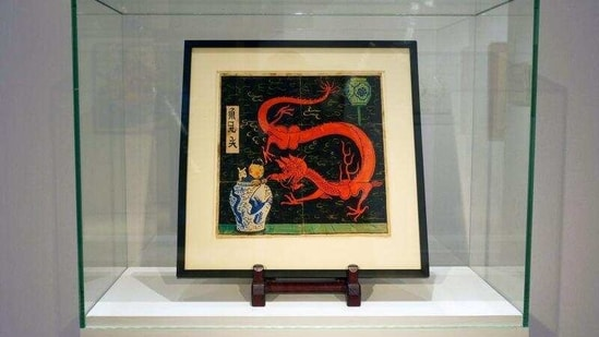 """Painting for the original cover of """"The Blue Lotus"""" (Lotus Bleu) Tintin comic book (1936), is displayed before being auctioned by Artcurial in Paris, France January 13, 2021.(Reuters)"""