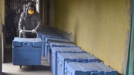 Tezpur: A worker arranges boxes containing Covishield vaccine doses for their dispatch across the Sonitpur district, in Tezpur, Friday, Jan. 15, 2021. A countrywide COVID-19 vaccination drive is set to rollout from January 16, 2021. (PTI Photo) (PTI01_15_2021_000220B)(PTI)