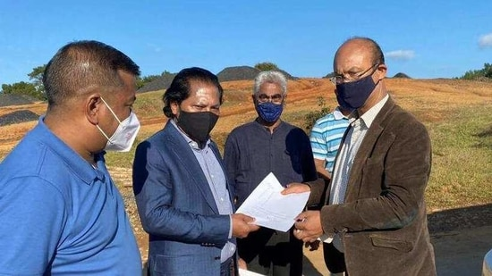 Former Meghalaya CM Dr Mukul Sangma receiving a report from West Jaintia Hills deputy commissioner Dykes detailing the identified stock of fresh coal identified at the spot.(HT photo)