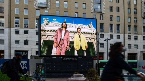 "A screen displays a broadcast of the Fall/Winter 2021 Men's fashion collections by the Italian Chamber of Italian Fashion (Camera Nazionale della Moda Italiana ) on January 15, 2021 in downtown Milan, on the opening day of a four-day so-called ""phygital fashion week"", a mix of digital and physical shows, during the COVID-19 pandemic caused by the novel coronavirus..(AFP)"