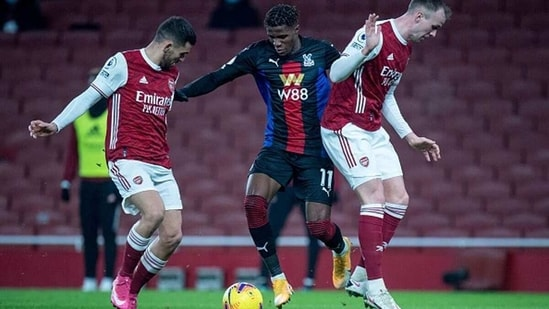 Dani Ceballos, Rob Holding of Arsenal and Wilfried Zaha of Crystal Palace in action. (Getty)