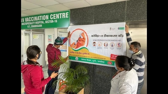 Hospital staff at GMSH, Sector 16, Chandigarh, readying the premises for the vaccination drive starting on Saturday. (HT Photo)