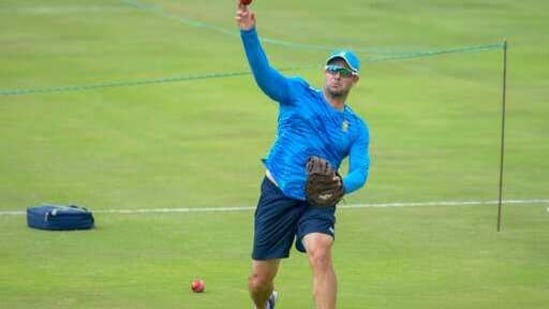 South African head coach Mark Boucher throws the ball during the pre-warmup on day two of the first cricket test match between South Africa and Sri Lanka at Super Sport Park Stadium in Pretoria, Sunday, Dec. 27, 2020. (AP Photo/Catherine Kotze)(AP)