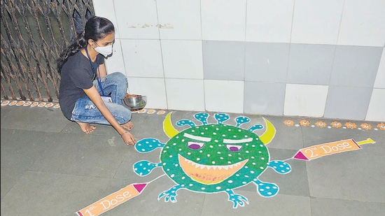 A rangoli marks the vaccine for Covid-19 at a KDMC centre in Kalyan on Friday. (Rishikesh Choudhary/HT)