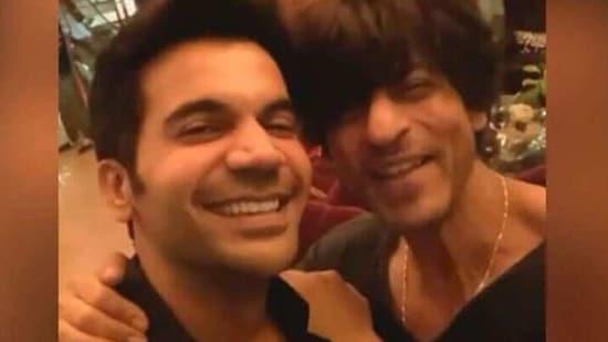 Rajkummar Rao poses with Shah Rukh Khan.