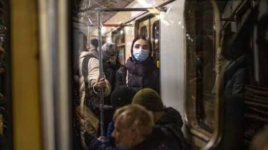 A woman wearing a face mask to help curb the spread of the coronavirus rides a subway car in Moscow, Russia,(AP)