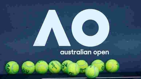 FILE PHOTO: Tennis - Australian Open - Melbourne, Australia, January 14, 2018. Tennis balls are pictured in front of the Australian Open logo before the tennis tournament. REUTERS/Thomas Peter/File Photo(REUTERS)