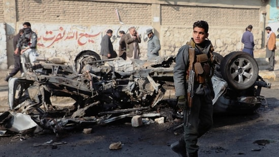 An Afghan police officer keeps watch at the site of a bomb blast in Kabul, Afghanistan.(REUTERS)