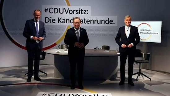 FILE PHOTO: The three candidates for the chairmanship of Germany's Christian Democratic Union (CDU) party, from left to right, Friedrich Merz, Armin Laschet and Norbert Roettgen, pose at the end of a debate at party headquarters in Berlin, Germany, January 8, 2021. REUTERS/Christian Mang/Pool/File Photo(REUTERS)