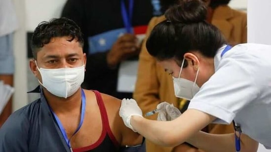Sanitation worker Manish Kumar, who according to the officials is the first person in the country vaccinated against the Covid-19 in Delhi.(REUTERS)