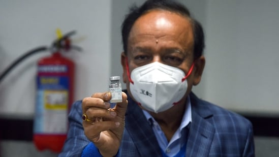 Union Health Minister Harsh Vardhan shows a dose of COVAXIN developed by Bharat Biotech at AIIMS in New Delhi on Saturday as the first phase of vaccination begins across the country. (ANI Photo)