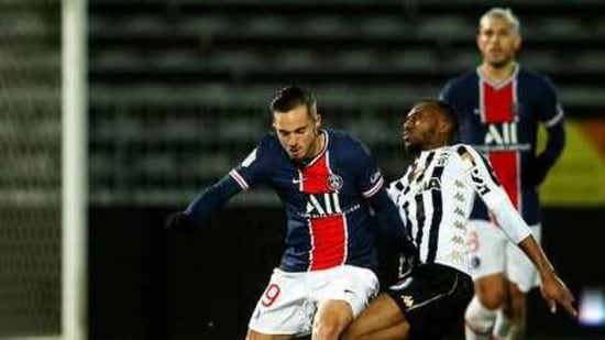 PSG's Pablo Sarabia, left, controls the ball during the French League One soccer match between Angers and Paris Saint-Germain at Jean-Bouin stadium in Angers, France, Saturday, Jan. 16, 2021. (AP Photo/David Vincent)(AP)