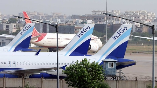 Aircrafts operated by IndiGo, a unit of InterGlobe Aviation Ltd parked at Terminal 3 of Indira Gandhi International Airport in New Delhi(Bloomberg)