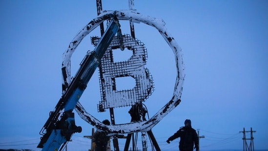 A bitcoin sculpture made from scrap metal is installed outside the BitCluster cryptocurrency mining farm in Norilsk, Russia.(Bloomberg)