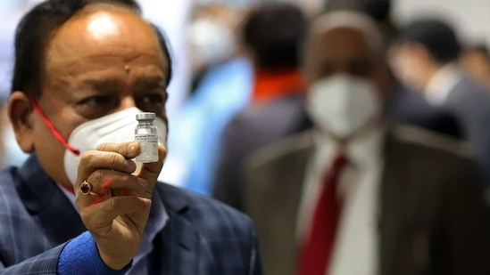 Union health minister Harsh Vardhan displays a vial of Bharat Biotech Ltd. Covaxin at the All India Institute of Medical Sciences in New Delhi on Saturday. (Bloomberg Photo )