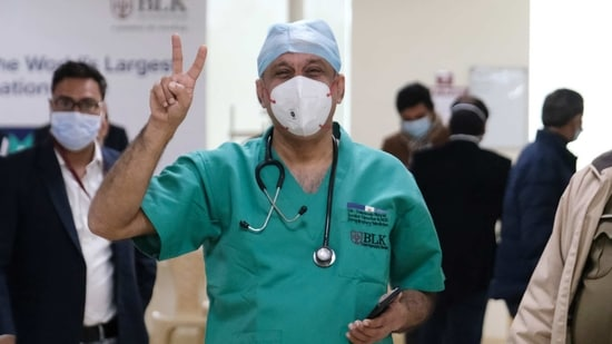 Dr Sandeep Nayar, the first beneficiary of Covishield vaccine, developed by Oxford-AstraZeneca Plc. and manufactured by Serum Institute of India Ltd, gestures at the BL Kapoor Super Specialty Hospital in New Delhi on Saturday. Bloomberg