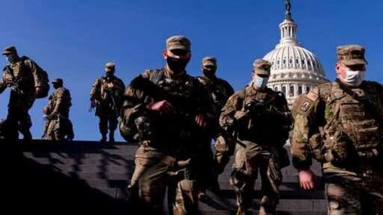 Members of the National Guard walk past the dome of the Capitol Building on Capitol Hill in Washington.(AP)