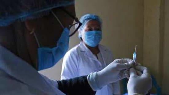 File photo: A nurse prepares a syringe with Covid-19 vaccine. (AP)