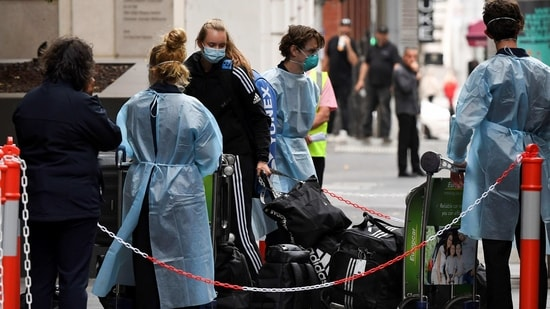 Tennis players, coaches and officials arrive at a hotel in Melbourne on January 15, 2021, before quarantining for two weeks ahead of the Australian Open tennis tournament. (Photo by William WEST / AFP)(AFP)