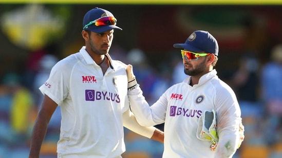 Brisbane: India's Washington Sundar, left, is congratulated by teammate Rishabh Pant.(AP)