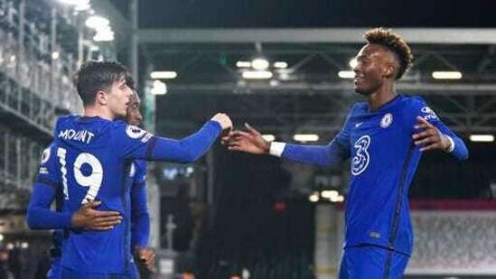 Chelsea's Mason Mount, left, celebrates with Chelsea's Tammy Abraham, right, after scoring during the English Premier League soccer match between Fulham and Chelsea at Craven Cottage in London, England, Saturday, Jan. 16, 2021. (John Walton/Pool via AP)(AP)