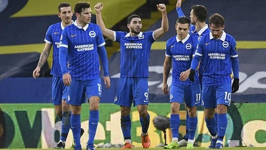 Brighton and Hove Albion's Neal Maupay (centre) celebrates with his team-mate after scoring his side's first goal. (Getty)