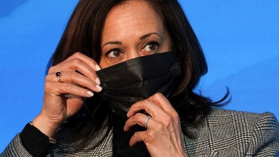 US Vice President-elect Kamala Harris adjusts her mask at transition headquarters in Wilmington, Delaware, US.(Reuters)