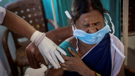 A healthcare worker reacts as she receives a dose of Covid-19 vaccine at Mathalput Community Health Centre in Koraput district of Odisha. (Reuters File Photo )
