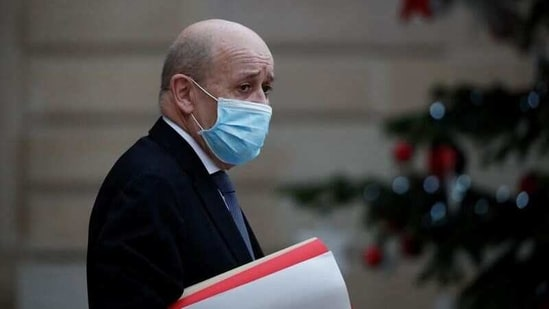 French Foreign Minister Jean Yves Le Drian, wearing a protective face mask, leaves following the weekly cabinet meeting at the Elysee Palace in Paris, France, (Reuters)