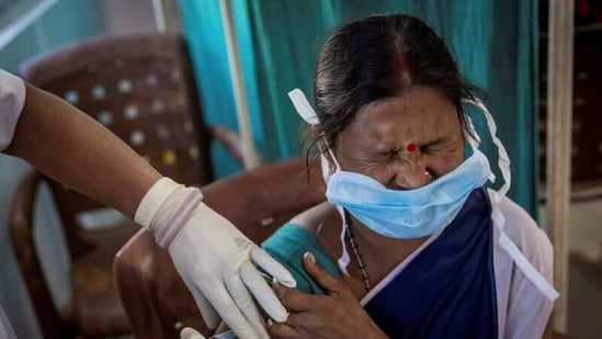 A healthcare worker receives a dose of a COVID-19 vaccine in Koraput district of the eastern state of Odisha, India. (Reuters)
