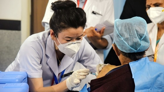 A health worker receives a Covid-19 vaccine shot, at AIIMS in New Delhi on Saturday. (ANI Photo)