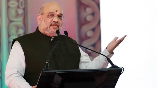Home Minister Amit Shah addresses during laid the foundation stone of the 97th battalion of Rapid Action Force (RAF) in Bhadravathi on Saturday. (ANI Photo)