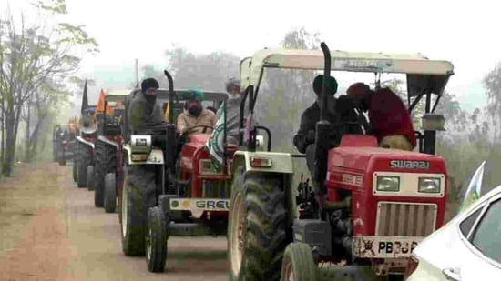 Farmers leave from Ludhiana for Delhi to participate in a tractor march, on Sunday. (ANI Photo)