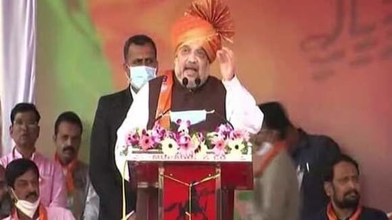 Home Minister Amit Shah addresses during the inauguration of the Ethanol projects of M/S Kedarnath Sugar and Agro products at Karakalmatti village in Bagalkot on Sunday. (ANI Photo)