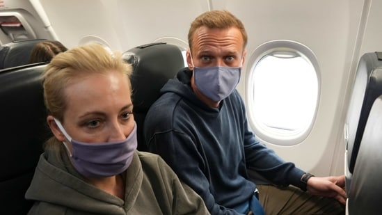 Alexei Navalny and his wife Yulia sit in the plane prior to flight to Moscow in the Airport Berlin Brandenburg in Schoenefeld, Germany.(AP)
