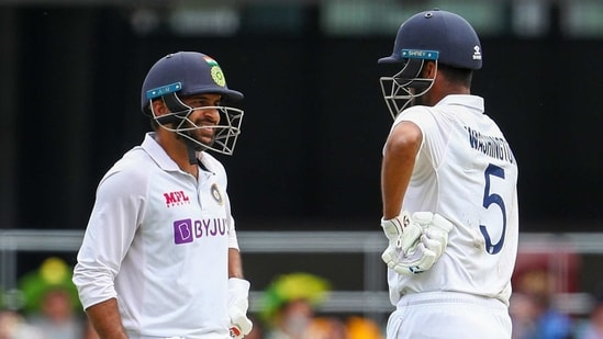 India's Shardul Thakur, left, and teammate Washington Sundar talk during play on day three of the fourth cricket test between India and Australia at the Gabba, Brisbane, Australia.(AP)