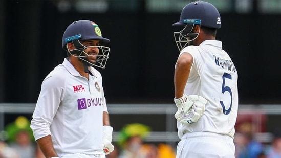 India's Shardul Thakur, left, and teammate Washington Sundar talk during play on day three of the fourth cricket test between India and Australia at the Gabba, Brisbane, Australia, Sunday, Jan. 17, 2021. (AP Photo/Tertius Pickard)(AP)