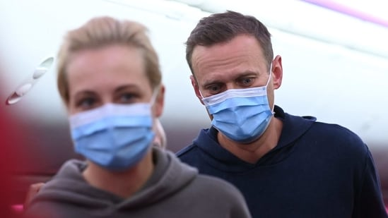 Russian opposition leader Alexei Navalny and his wife Yulia are seen in a Pobeda plane heading from Berlin to Moscow.(AFP)